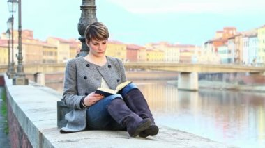 Girl Reading a Book along the River — Vídeo de stock