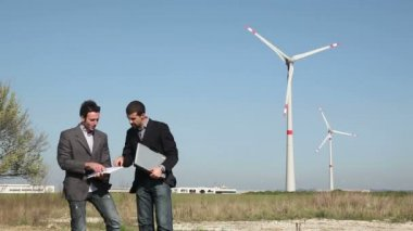 Engineers in front of Wind Turbine for Power Generation — Stock Video