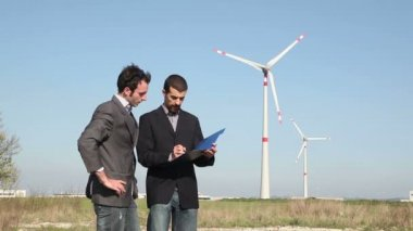 Engineers in front of Wind Turbine for Power Generation — Video Stock