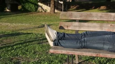 Woman Lying on a Bench at Park — Vídeo de Stock