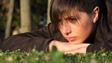 Beautiful Young Woman Lying on Grass — Стоковое видео