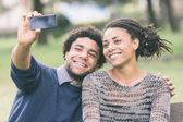 Mixed-Race Couple Taking Selfie — Stock Photo