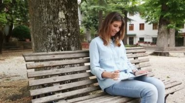Young Woman Using Digital Tablet Outdoor — Stock Video