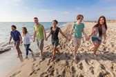 Multiracial Group of Friends Walking at Beach — Stock Photo