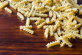 Fusilli, Italian Pasta, on Wooden Table — Stock Photo