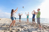 Multiracial Group of Friends Playing Volleyball at Beach — Stock Photo
