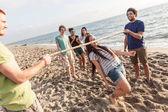 Friends Dancing Limbo at Beach — Stock Photo