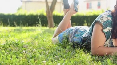 Woman writing in her diary on the lawn — Stok video