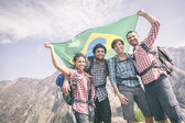 People with Brazilian Flag on top of Mountain — Stock Photo