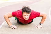 Young Man doing Push-up exercises — Stock Photo