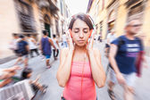 Beautiful Young Woman Listening Music in the City — Stock Photo