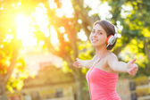Carefree Girl with Headphones Listening Music at Park — Stock Photo
