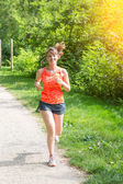 Beautiful Young Woman Jogging at Park — Stock Photo