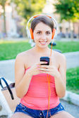 Beautiful Girl with Mobile Phone at Park — Stock Photo