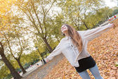Joyful Woman at Park in Autumn — Stock Photo