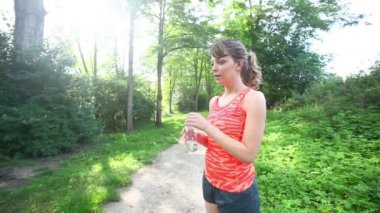 Beautiful Young Woman Drinking Water after Fitness Exercises — Stock Video