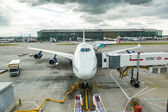 LONDON, UNITED KINGDOM - AUGUST 19, 2014: British Airways Boeing 747 at London Heathrow airport with some more aircrafts on background — Stock Photo