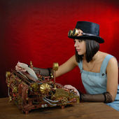 Steam punk girl with Typewriter. — Stock Photo