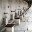 Washing place outside a mosque - Stock Photo