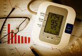Decline charts and high blood pressure. — Stock Photo