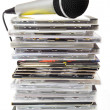 Microphone and karaoke compact discs collection — Stock Photo