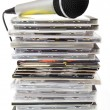 Microphone and karaoke compact discs collection — Stock Photo #32756477