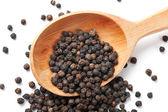 Pimienta negra en grano — Foto de Stock