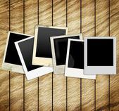 Old Polaroid Frames on wood background — Stock Photo