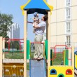 Father with son on slide - Stock Photo
