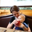 Stock Photo: Mother gives to drink to son