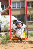 Baby swinging on swing — Stock Photo