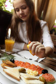 Girl in seafood restaurant — Stock Photo