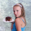 Girl and piece of cake - Stock Photo