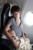 Mother with baby at airplane — Stock Photo