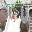 Family on a waterslide — Stock Photo #13259000