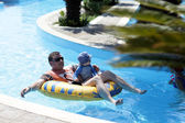 Father with baby on swim ring — Stock Photo