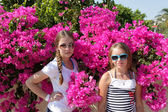 Two girls in garden — Stock Photo