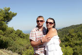 Portrait of couple on valley background — Stockfoto