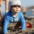 Toddler crawling on beach — Stock Photo