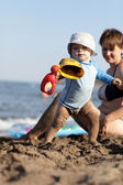 Toddler with toy on beach — Stock Photo