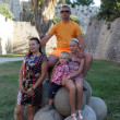 Family on cannonballs — Stock Photo