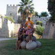 Family on castle of Rhodes background — Stock Photo