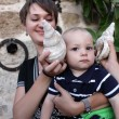Baby and shell — Stock Photo