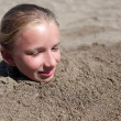 Stock Photo: Kid buried in sand