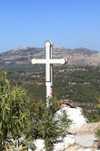 White cross of Tsambika monastery — Stock Photo