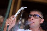 Man smoking hookah — Stock Photo