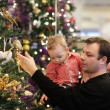 Father with son spending time by Christmas tree — Stock Photo
