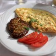Omelet with cutlet - Stock Photo