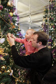 Father with son near Christmas tree — Stock Photo