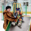Toddler on slide — Stockfoto #18876001